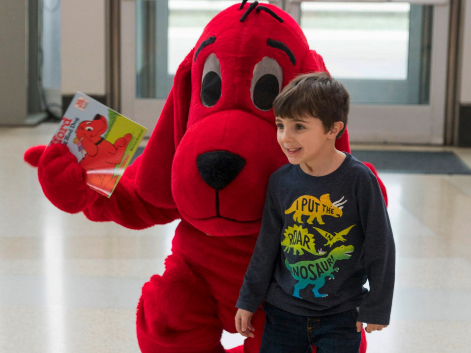 Child with Clifford the Big Red Dog
