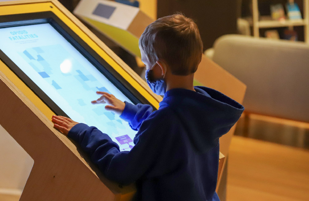 Kid Interacts with touch screen